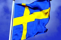 616px-Swedish_flag_with_blue_sky_behind_ausschnitt