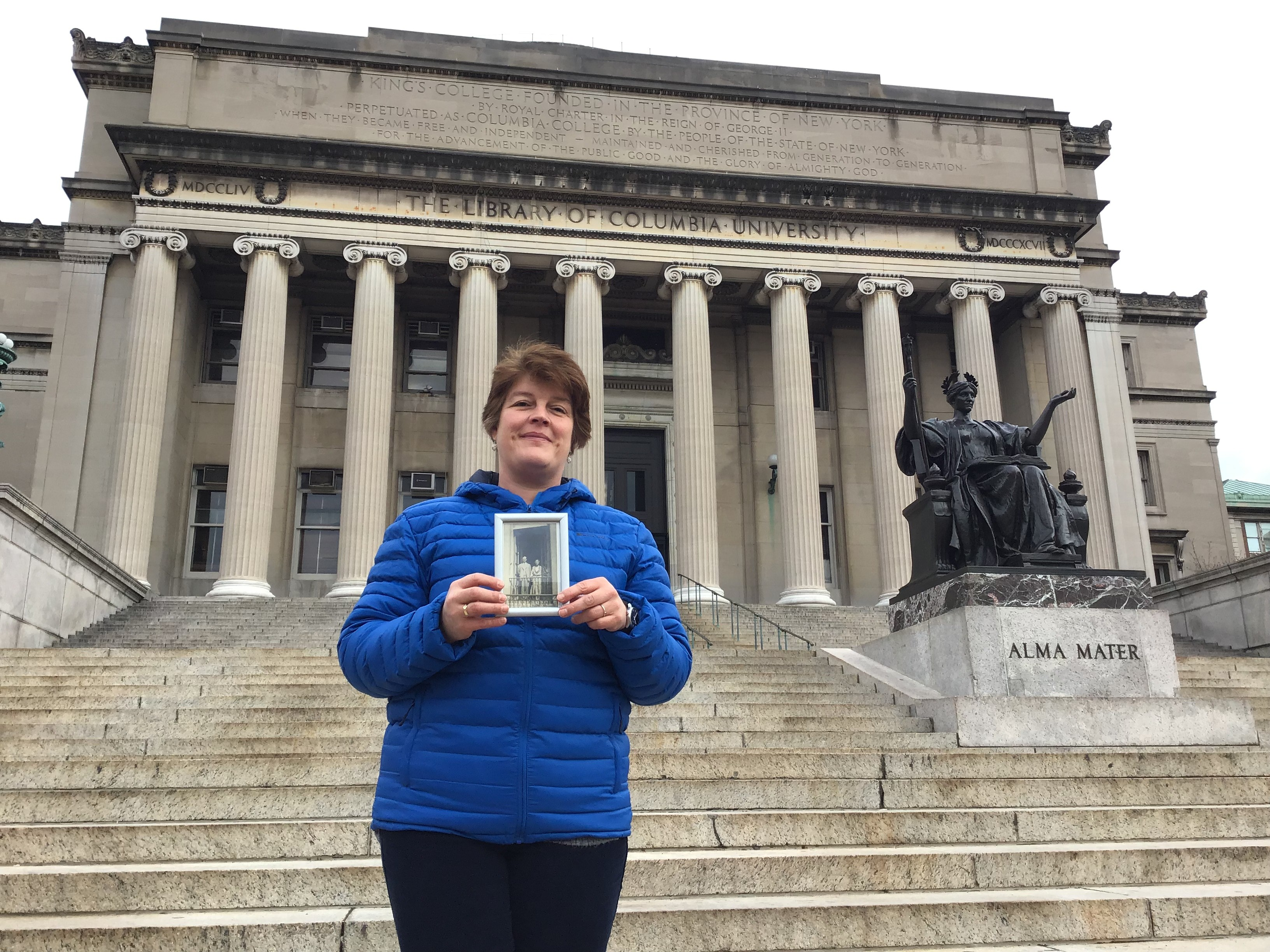 Alice Lewthwaite on the steps of Low Memorial Library Columbia University NYC with a picture of Harry & Florence Edmond - this is where Harry met the Chinese student in 1909.